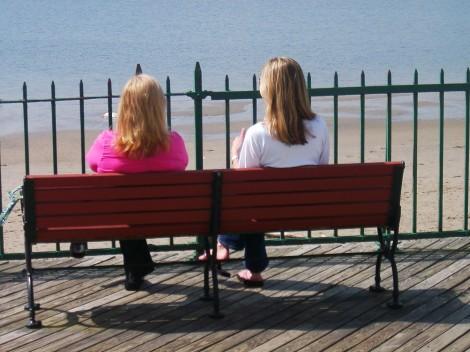file561270689520women female ladies girls water beach bench